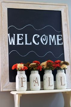 Fall mason jar vases painted with chalk paint and used for Holiday decor---I love <3