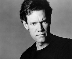 Randy Travis... I remember when he was in touched by an angel. And then I found out he was a singer too lol!!! there's nothing he could do that would stop me from admiring him!