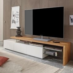 Alanis Modern TV Stand In Knotty Oak And Matt White With 3 Drawers And Glass Shelves is the perfect fresh design for modern home decor. This Stunning TV Stand body is made of MDF Matt White With To...