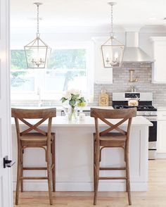 We're got a serious #josskitchencrush on @jaclynmari_'s bright white space! Shop the perfect barstool + pendant combination for your #kitchen by heading to the link in our profile. #kitcheninspo #lookswelove #designinspo