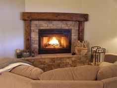 My multi-talented husband did this entire fireplace and surround, with barn beam mantle and side posts.