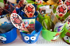 Little buckets at the 99 cent store and print outs on large page-size labels.  About 4-5 us spent the time to cut out the labels and apply them to the buckets.  Add colorful candy, a small toy, and a Yo Gabba sticker and you've got a Yo Gabba Gabba themed party take-away. Kids loved them.