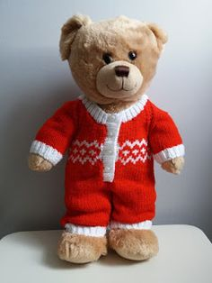 A teddy bear onesie using double knit, with either plain or an easy fair isle pattern. A teddy bear onesie using double knit, with either plain or an easy fair isle pattern. Teddy Bear Knitting Pattern, Knitted Teddy Bear, Crochet Teddy, Baby Knitting Patterns, Free Knitting, Doll Patterns, Crochet Onesie, Knitting Toys, Bears