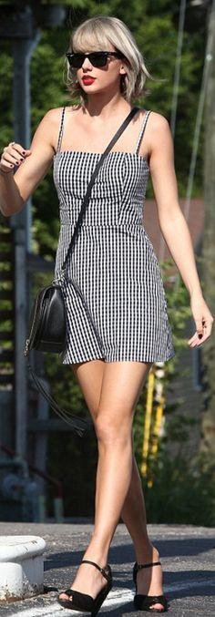 Who made  Taylor Swift's black sunglasses, white print dress, sandals, and handbag?