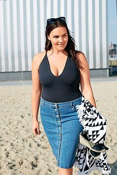 The button-front denim pencil skirt is one of our favorite spring and summer fashion trends. Click to see more of them and ideas on how to wear them from model Candice Huffine.