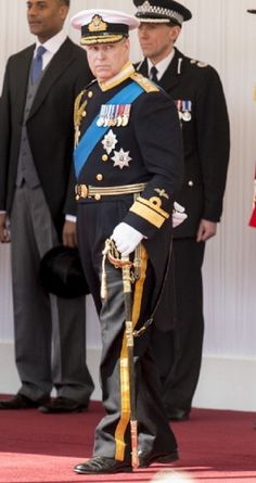 Prince Andrew, Duke of York waits for The President of the UAE on the Royal Dais at in Windsor, England.