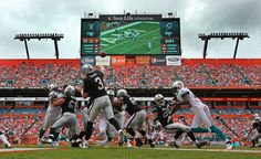 Carson Palmer #3 of the Oakland Raiders passes during a game against the Miami Dolphins at Sun Life Stadium on September 16, 2012 in Miami Gardens, Florida.