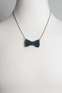 Too cheesy to have the Groomsmen wearing actual navy bowties and the Bridesmaids wearing this? ...I'm being mildly serious.