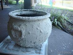 cheap plastic cauldron tranformed. Primed, thn mixed low voc latex paint, with lots of sand (for texture) and some flour (for glue). Paint