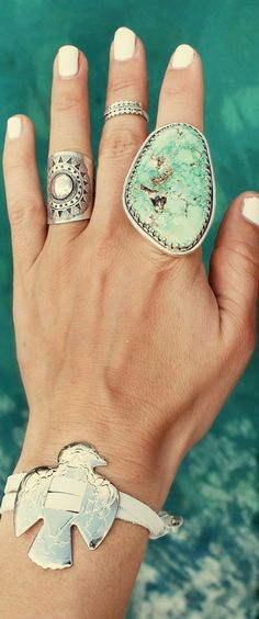 Love the fun use of jewelry. Especially the large stone pointer finger ring