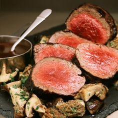 Wolfgang Puck's Roast Beef Tenderloin with Mushroom Madeira Sauce - looks delicious and easy enough to make at home.