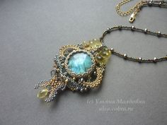 "Pendant ""Moon fish"". Beaded jewelry by Ulyana Moldovyan. Labradorite, seed beads, crystal beads."