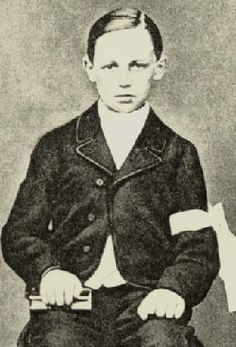French poet Arthur Rimbaud at the time of his First Communion, age 11, 1866.