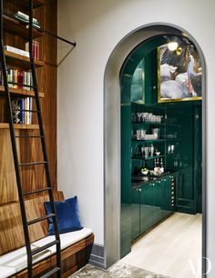 A painting by Angela Gram is mounted in the green-lacquer bar off the library   archdigest.com