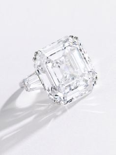 a platinum and diamond ring set with a 38.27-carat square Emerald-cut diamond with D color, VVS2 clarity and type IIA origin sold for just over $4 million, within its estimate.