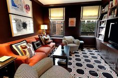 An Office and A Gentleman: geometric pattern play in his chocolate brown gents den. Interior Designer: Christina Murphy.