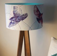 A breath of fresh air! Beki Gowing's stunningly light 'blue birds' design captures the essence of space and movement. SMALL: 20cm diameter shades = Height 30cm: These are small table lamps and work well wth a small or short lamp base as they are slightly taller than our other shades. They would also work well as a pair of bedside lamps. These could also work as a ceiling pendant, but better in a small room, hallway or similar. MEDIUM: 30cm diameter shades = Height 21cm. Thses work best as…