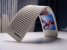 Nokia 888 futuristic flex phone.....Um I am going to need this... no more broken phones ;)