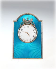 Fabergé Table Clock; 1907–1917; silver, guilloche enamel, gold, ivory, glass (Hodges Family Collection)