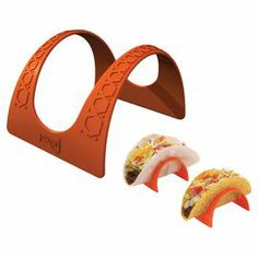 """Easily adorn your tacos with your favorite fillings on this essential stand, perfect for hard or soft-shell tortillas.   Product: Set of 4 taco standsConstruction Material: PlasticColor: OrangeFeatures:  Holds taco for filling or platingUse with hard or soft tacosDimensions: 7.5"""" H x 2.5"""" W x 4"""" D"""