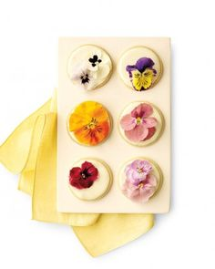 """Edible Flower Cookies""  Sugar cookies,baked, cooled and iced. Add  REAL pansies for decoration."