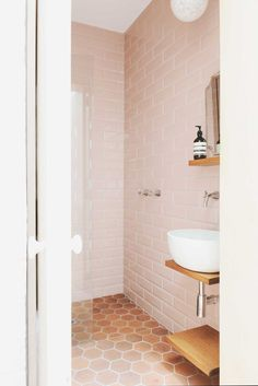 large elongated bevel tile in the prettiest pink and terracotta hexagons on the floor