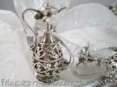 http://tophatter.com/auctions/11540?campaign=all=internal    1 Silver Plated Ornate Magic Lamp Sweater pendant $5