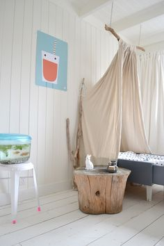 DIY Canopy Bed Made from a Branch. I like the side table stump, but I would want the branch to run lengthwise above the bed. It looks awkward this way Ideas Dormitorios, Diy Canopy, Canopy Beds, Bed Curtains, Canopies, Tent Canopy, Hotel Canopy, Window Canopy, Wooden Canopy