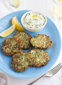 Zucchini and feta fritters - an absolutely delicious side dish for any meal!  I make garlic aioli instead of their dip.