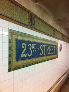 Another example of nice NYC subway tiled street names, against white subway tile. Want to do this for the backsplash in my kitchen.
