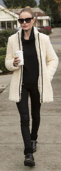 Kate Bosworth breaks up her all-black outfit with a chic fuzzy white coat