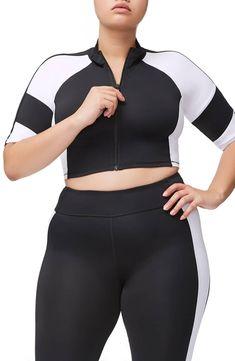 5413d8928f A zippy crop top takes its cues from professional athletic gear