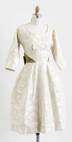 vintage 1960s creamy damask wedding dress with olive green satin bow.