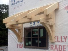 timber frame front entrance pictures frame pavilion crew amongst timbers assembling the peak right side Porch Overhang, Porch Awning, Patio Awnings, House Awnings, Window Awnings, Awning Over Door, Door Design, House Design, Porch Roof Design