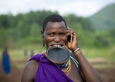 The beginning of the end? Surma woman with mobile phone - Ethiopia by Eric Lafforgue, via Flickr