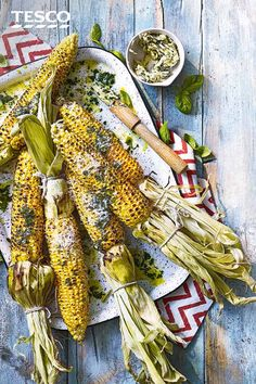 Ramp up the flavour of your bbq corn on the cob this summer by adding a rich Parmesan and basil butter. The fragrant butter melts over the smoky, charred corn for a delicious veggie bbq recipe. Veggie Bbq, Vegetarian Barbecue, Barbecue Recipes, Bbq Corn On The Cob, Smoke Bbq, Tesco Real Food, British Baking, Bank Holiday Weekend, Grilled Vegetables