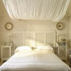 i like the ceiling draping, only i would do a pattern, something interesting for baby to look at while laying on their back