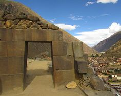 Ollantaytambo: Even just briefly observing this magnificent trapezoidal doorway, with the typical Inca stonework on top, how could anyone believe that these two types of stonework could be created by the same workers? The stones of the doorway are incredibly precisely cut and finished from giant blocks without mortar; apparently Incan work on top, crude, small, and rough -- I think the patch was done ages after the people who created the doorway were gone or their technology lost.
