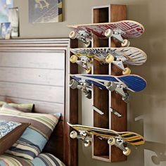 For my big (little) brother who still skates! This functional wall design turns your best boards into high art. The grab-and-go case is built of solid wood and holds five skateboards.