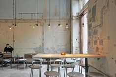 "In Gothenburg, Sweden, architect Axel Robach transformed a historic auction house into a cafe and multipurpose space but left the original walls exposed to ""use the soul of the room and its humble character"" as a design element. From Restaurant Visit: Past Present at Kafe Magasinet in Sweden."