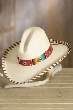 """Crafted from lightweight, sturdy palm leaf from Guatemala, our bold hat offers a generous 4"""" brim with upturned edge."""