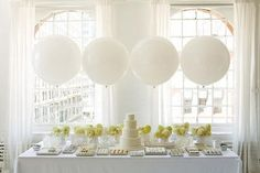 LOVE the white balloons and green flower centerpiece