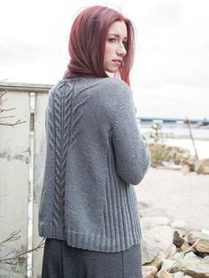 The Ropewalk pullover is interesting from every angle. The a-line silhouette is shaped with slanting ribbed side panels that draw the eye toward cabled center front and back panels. Cable pattern is charted.