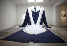 """Ximena Zomosa ~ """"Welcome"""" Installation Dress. 530 x 200 cm. """"The body is replaced by the dress that covers it. Empty, it fills the space in all its gigantism, like the image of a woman, mother or ghost in certain dreams.""""~XY Shown here at La Sala Gallery 2010 via Flickr 