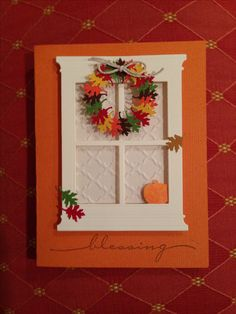 handmade Thanksgiving card ... die cut window in white with wreath of punched leaves in Fall colors ... beautiful on rich rusty orange card base ...