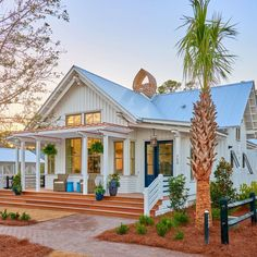 For Sale: This Lowcountry Bungalow Is a Perfect Blend of Farmhouse and Beach House The exterior of a contemporary Lowcountry house, with white siding and a blue metal roof. Coastal Farmhouse, Coastal Cottage, Coastal Homes, Cottage Homes, Coastal Living, Farmhouse Front, White Cottage, Southern Living, Coastal Decor