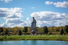 Lake hope lies in front of Our Lady Of Guadalupe statue located at the Servants of Mary Center For Peace in Windsor, Ohio. The statue, also known as the Virgin of Guadalupe, is the tallest in the world, standing 50 feet tall and is covered by over 450,000 mosaic tiles.