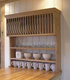 Another take on plate racks, storage. I could maybe do this on both sides of window. Another take on plate racks, storage. I could maybe do this on both sides of window. Wooden Plate Rack, Plate Rack Wall, Wooden Plates, Diy Kitchen Storage, Kitchen Shelves, Kitchen Cabinets, New Kitchen, Kitchen Dining, Kitchen Decor