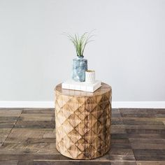 """Carefully carved wood creates a diamond pattern that exposes the Olive side table's fluid marbling. Surprisingly light, the Olive adds a natural design element to your space without overwhelming. Dimensions: L: 20"""" W: 20"""" H: 22""""Materials: WoodColors: Wheat"""