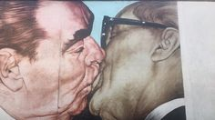 This photograph was taken at the Berlin Wall East Side Gallery in Berlin. Pictured are two communist leaders, Soviet leader Brezhnev and East Germany president at the time, Honecker embracing in a fraternal kiss. This painting was based on an actual photograph taken in 1979 celebrating the 30 year anniversary of the German Democratic Republic. This image was placed on the Berlin Wall to make a stab at the once communist Germany and Soviet Union, and represent how communism is no more.